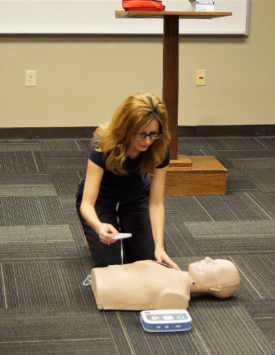 Kelli instructing Automated External Defibrillator pad placement