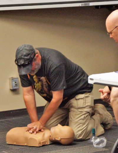 Student learning chest compressions on adult mannequin