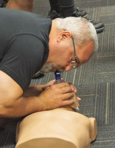 Student learning the correct way to give breaths