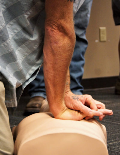 Close-up of Chest Compressions being preformed